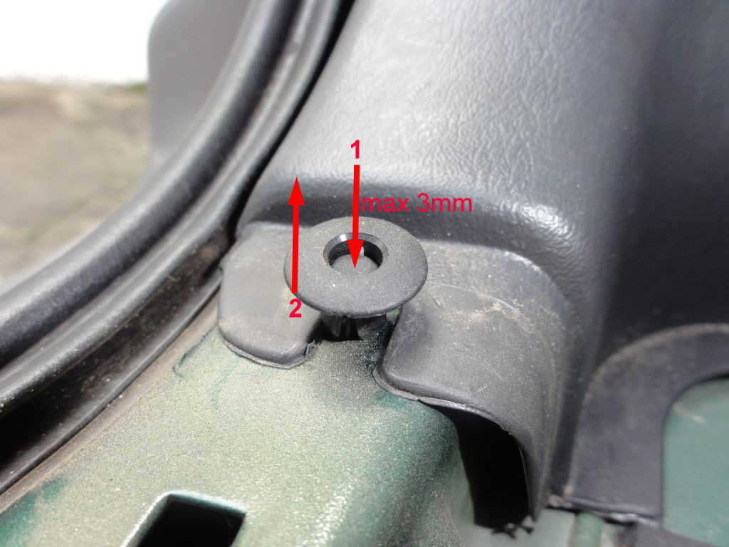 To unlock this clip, push the center about 2 or 3mm and then lift the entire piece. Don't push more than 3mm otherwise you'll lose the center pin inside your car body. The clip from this picture can be seen after you remove the back trim.