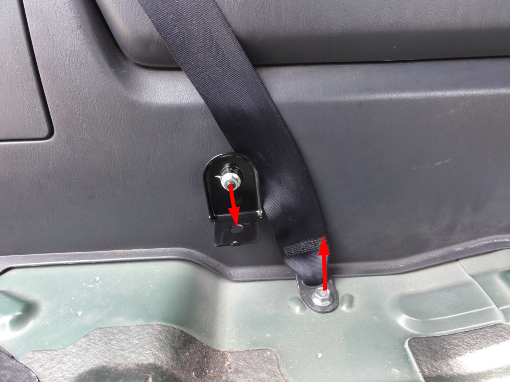 Remove the pivot holding bolt (13mm hex). Loose the rear seat belt screw. NOTICE: Remember to tighten this screw after assembling the trims and before installing the seats.